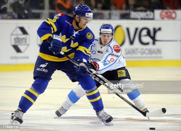 Carl Gunnarsson of Sweden vies for the puck with Antti Pihlstrom of Finland during their Euro Ice Hockey tour match Sweden vs Finland on April 23...