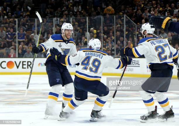 Carl Gunnarsson of the St Louis Blues celebrates his overtime goal with teammates Ivan Barbashev and Alex Pietrangelo after he scored in overtime...