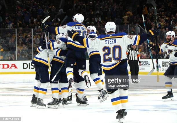 Carl Gunnarsson of the St Louis Blues celebrates with teammates after scoring the gamewinning goal during the first overtime period to defeat the...