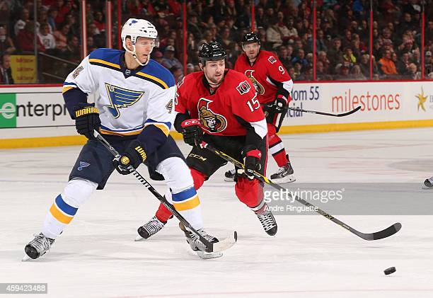 Carl Gunnarsson of the St Louis Blues controls the puck against the forechecking of Zack Smith of the Ottawa Senators at Canadian Tire Centre on...