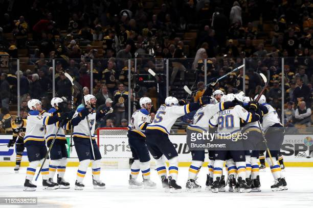 Carl Gunnarsson of the St Louis Blues is congratulated by his teammates after scoring the game winning goal during the first overtime period against...