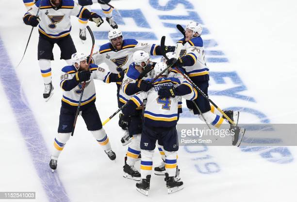 Carl Gunnarsson of the St Louis Blues is congratulated by his teammates after scoring the gamewinning goal during the first overtime period to defeat...