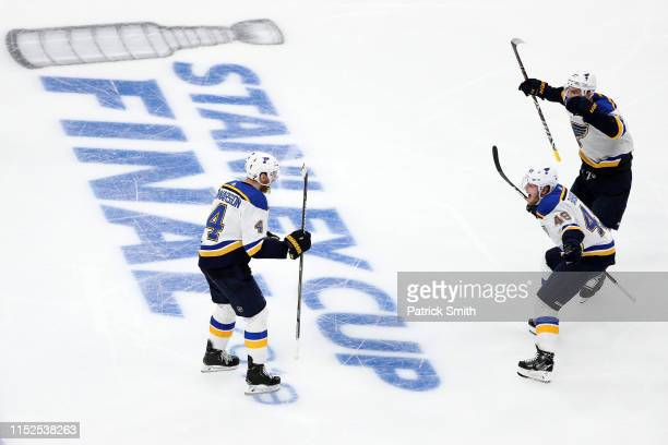 Carl Gunnarsson of the St. Louis Blues is congratulated by his teammates Ivan Barbashev and Alex Pietrangelo after scoring the game winning goal...