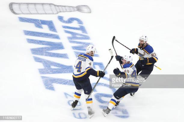 Carl Gunnarsson of the St Louis Blues is congratulated by his teammates Ivan Barbashev and Alex Pietrangelo after scoring the gamewinning goal during...