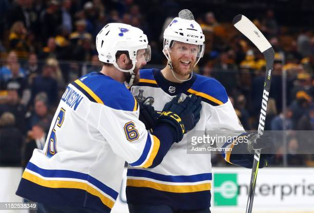Carl Gunnarsson of the St Louis Blues is congratulated by his teammate Joel Edmundson after scoring the game winning goal during the first overtime...