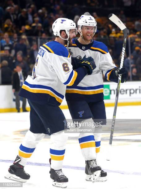 Carl Gunnarsson of the St Louis Blues is congratulated by his teammate Joel Edmundson after scoring the gamewinning goal during the first overtime...