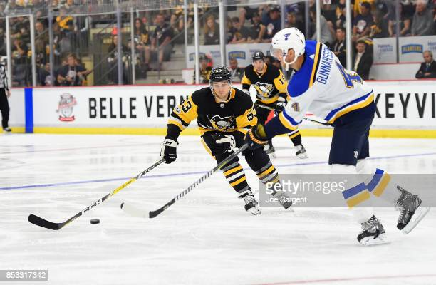 Carl Gunnarsson of the St Louis Blues moves the puck in front of Teddy Blueger of the Pittsburgh Penguins at UPMC Lemieux Sports Complex on September...
