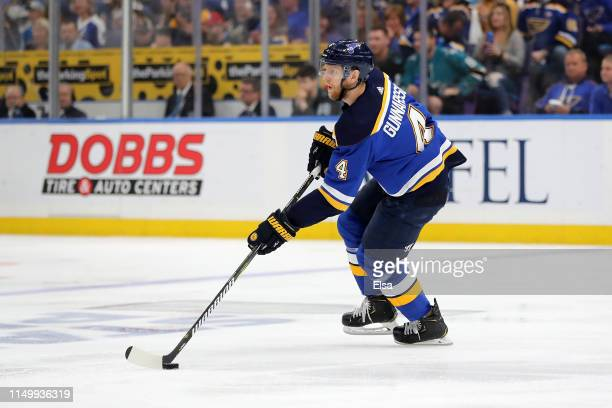 Carl Gunnarsson of the St Louis Blues skates with the puck against the San Jose Sharks during the first period in Game Four of the Western Conference...