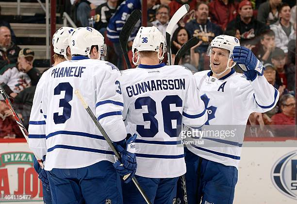 Carl Gunnarsson of the Toronto Maple Leafs celebrates with teammates Carter Ashton Dion Phaneuf and Jay McClement after his second period goal...