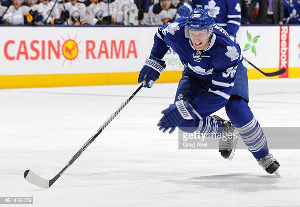 Carl Gunnarsson of the Toronto Maple Leafs skates during NHL game action against the Buffalo Sabres December 27 2013 at the Air Canada Centre in...
