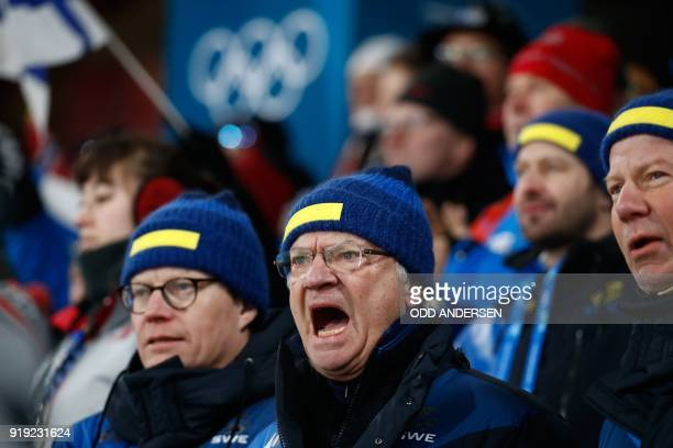 TOPSHOT Carl Gustaf King of Sweden cheers on his country's team during the women's 4x5km classic free style cross country relay at the Alpensia cross...
