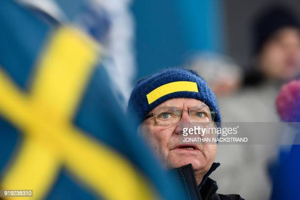 Carl Gustaf King of Sweden cheers on his country's team during the women's 4x5km classic free style cross country relay at the Alpensia cross country...