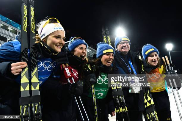 TOPSHOT Carl Gustaf King of Sweden poses with his country's team after the women's 4x5km classic free style cross country relay at the Alpensia cross...