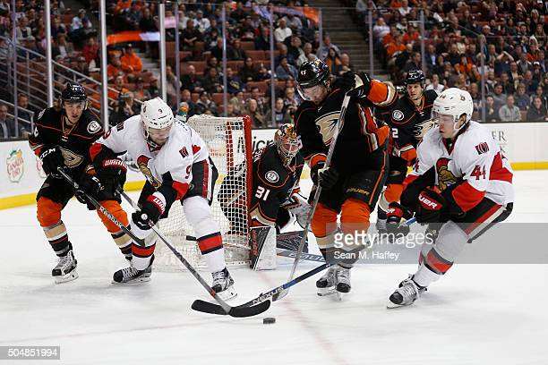 Carl Hagelin AND Sami Vatanen of the Anaheim Ducks and JeanGabriel Pageau of and Milan Michalek of the Ottawa Senators battle for a loose puck during...