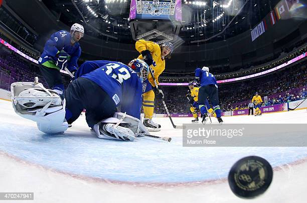 Carl Hagelin of Sweden shoots and scores against Robert Kristan of Slovenia in the third period during the Men's Ice Hockey Quarterfinal Playoff on...