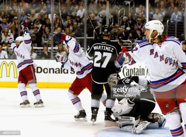 Carl Hagelin of the New York Rangers and teammates celebrate a goal scored by Ryan McDonagh as goaltender Jonathan Quick of the Los Angeles Kings...
