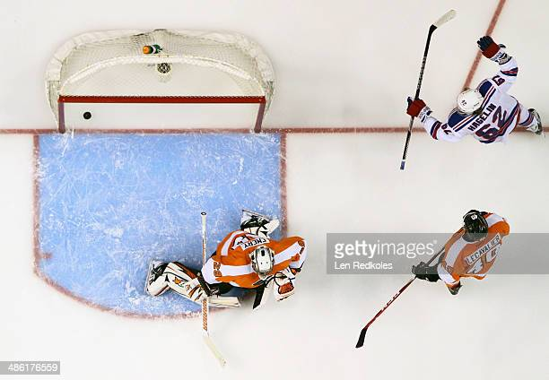 Carl Hagelin of the New York Rangers celebrates a first period goal against Ray Emery and Vincent Lecavalier of the Philadelphia Flyers in Game Three...