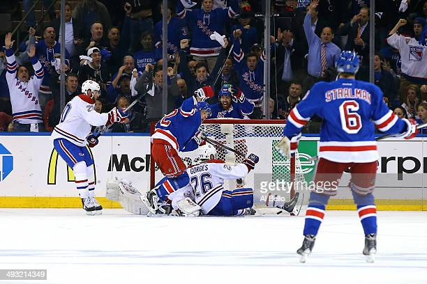Carl Hagelin of the New York Rangers celebrates his first period goal against the Montreal Canadiens in Game Three of the Eastern Conference Final...
