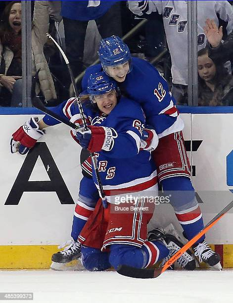 Carl Hagelin of the New York Rangers celebrates his goal at 1552 of the third period along with Jesper Fast against the Philadelphia Flyers in Game...