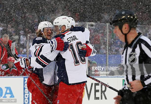 Carl Hagelin of the New York Rangers celebrates his second period goal against the New Jersey Devils with teammates during the 2014 Coors Light NHL...