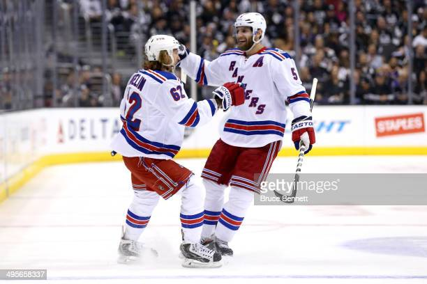 Carl Hagelin of the New York Rangers celebrates with Dan Girardi after scoring a goal in the first period against the Los Angeles Kings during Game...