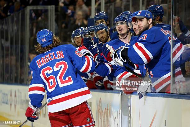 Carl Hagelin of the New York Rangers celebrates with his teammates on the bench after scoring a goal in the second period against MarcAndre Fleury of...