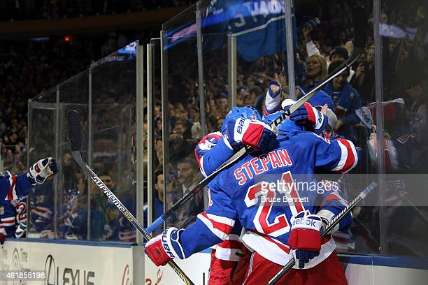Carl Hagelin of the New York Rangers celebrates with his teammates after scoring the game winning goal against Craig Anderson of the Ottawa Senators...
