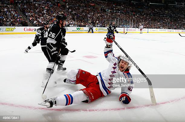 Carl Hagelin of the New York Rangers falss to the ice in the second period of Game One of the 2014 Stanley Cup Final against the Los Angeles Kings at...