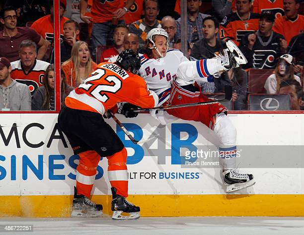 Carl Hagelin of the New York Rangers is hit by Luke Schenn of the Philadelphia Flyers during the first period in Game Four of the First Round of the...