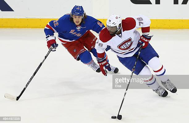 Carl Hagelin of the New York Rangers pursues PK Subban of the Montreal Canadiens during Game Six of the Eastern Conference Final in the 2014 NHL...