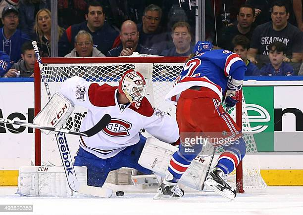 Carl Hagelin of the New York Rangers scores a goal against Dustin Tokarski of the Montreal Canadiens in the first period during Game Four of the...
