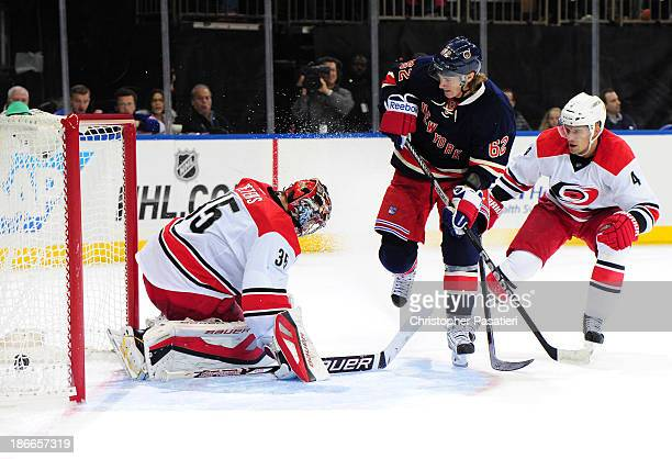 Carl Hagelin of the New York Rangers scores a goal against Justin Peters of the Carolina Hurricanes during the second period at Madison Square Garden...