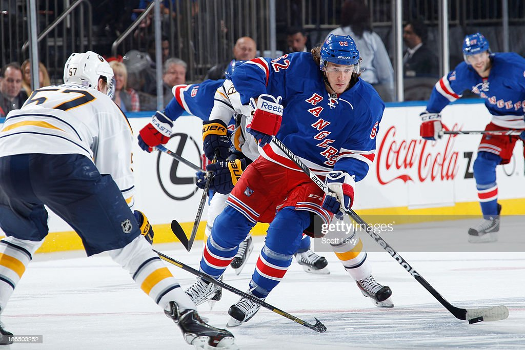 Carl Hagelin #62 of the New York Rangers skates the puck up the ice against the Buffalo Sabres at Madison Square Garden on October 31, 2013 in New York City.