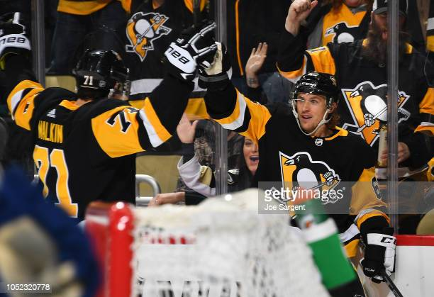 Carl Hagelin of the Pittsburgh Penguins celebrates his goal with Evgeni Malkin during the third period against the Vancouver Canucks at PPG Paints...