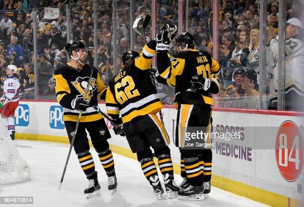 Carl Hagelin of the Pittsburgh Penguins celebrates with Patric Hornqvist after against the New York Rangers at PPG Paints Arena on January 14 2018 in...