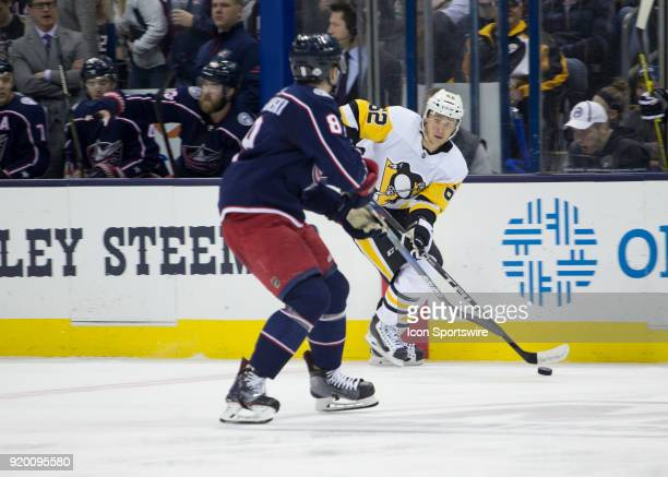 Carl Hagelin of the Pittsburgh Penguins skates with the puck during second period of the game between the Columbus Blue Jackets and the Pittsburgh...
