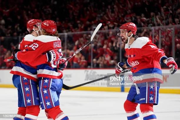 Carl Hagelin of the Washington Capitals celebrates with John Carlson and Brenden Dillon after scoring a goal against the Pittsburgh Penguins in the...