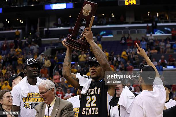 Carl Hall of the Wichita State Shockers holds up the West Regional Trophy after defeating the Ohio State Buckeyes 7066 during the West Regional Final...