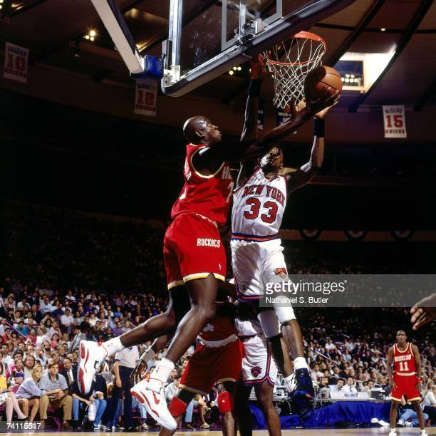 Carl Herrera of the Houston Rockets shoots a layup against Patrick Ewing of the New York Knicks during Game Five of the NBA Finals played on June 17...