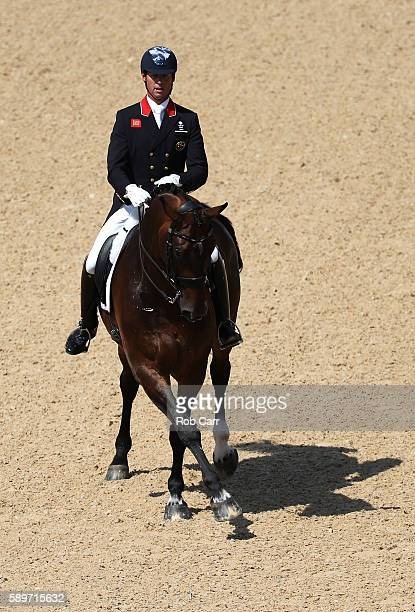 Carl Hester of Great Britain riding Nip Tuck competes in the Dressage Individual Grand Prix Freestyle on Day 10 of the Rio 2016 Olympic Games at...