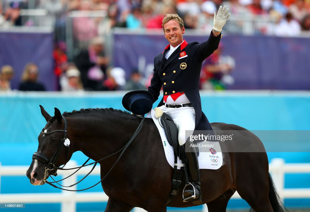 Carl Hester of Great Britain riding Uthopia celebrates after competing in the Team Dressage Grand Prix Special on Day 11 of the London 2012 Olympic Games at Greenwich Park on August 7, 2012 in London, England.