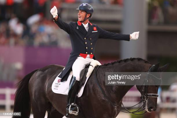 Carl Hester of Team Great Britain riding En Vogue reacts in the Dressage Team Grand Prix Special Team Final on day four of the Tokyo 2020 Olympic...