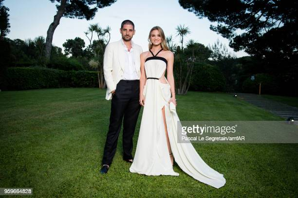 Carl Hirschmann and Fiammetta Cicogna pose for portraits at the amfAR Gala Cannes 2018 cocktail at Hotel du CapEdenRoc on May 17 2018 in Cap...