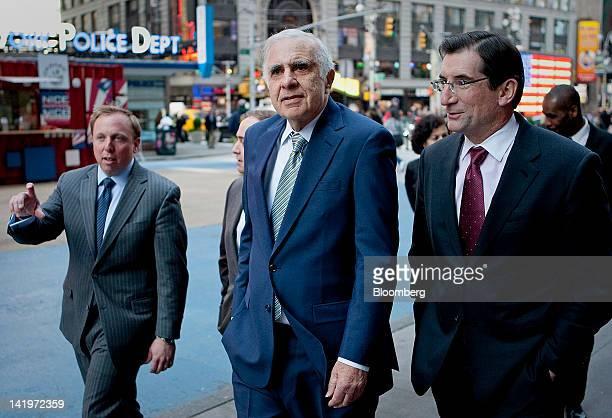 Carl Icahn billionaire investor and chairman of Icahn Enterprises Holdings LP center walks outside of the Nasdaq MarketSite with Robert Greifeld...