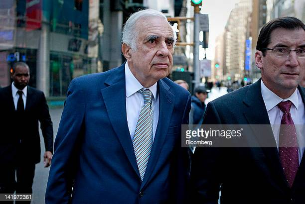 Carl Icahn billionaire investor and chairman of Icahn Enterprises Holdings LP left walks outside of the Nasdaq MarketSite with Robert Greifeld chief...
