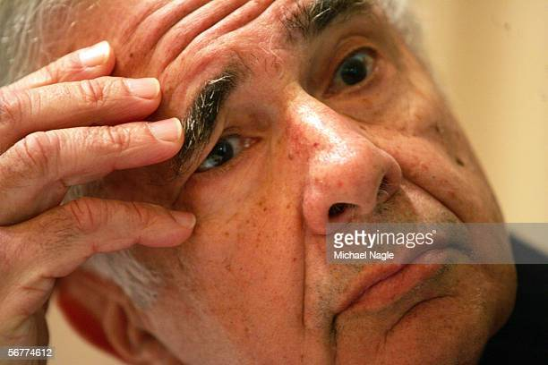 Carl Icahn looks at charts on a projection screen during a media conference at the St Regis on February 7 2006 in New York City Lazard issued a...