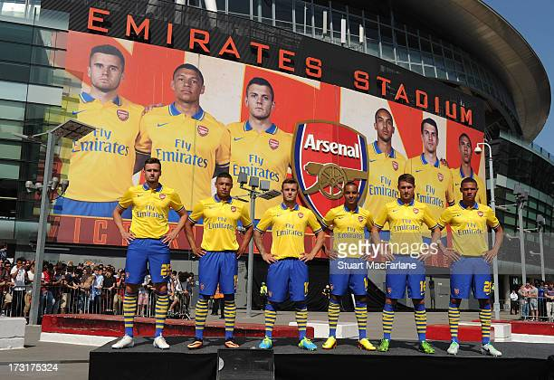 Carl Jenkinson Alex OxladeChamberlain Jack Wilshere Theo Walcott Aaron Ramsey and Kieran Gibbs of Arsenal poses during the launch of the new away kit...