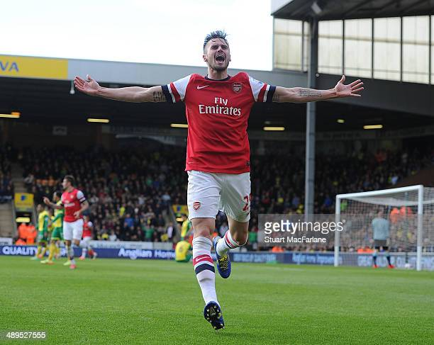 Carl Jenkinson celebrates scoring the 2nd Arsenal goal during the Barclays Premier League match between Norwich City and Arsenal at Carrow Road on...