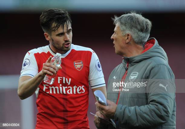 Carl Jenkinson of Arsenal chats to Arsenal U23s Assisntant Manager Carl Laraman during the Premier League 2 match between Arsenal U23 and Manchester...