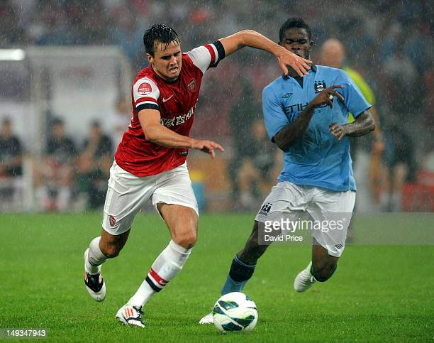 Carl Jenkinson of Arsenal FC holds of Razak of Manchester City during the preseason Asian Tour friendly match between Arsenal and Manchester City at...